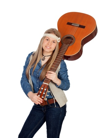Pretty girl with hippie clothes and a guitar isolated on white background photo