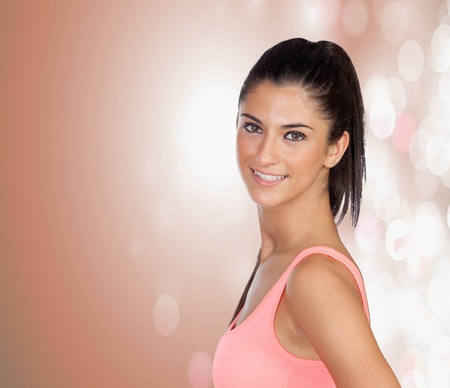 Attractive brunette girl with a pierced nose on a pink and bright background Stock Photo - 20432986