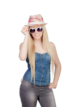 Young girl with a cap and sunglasses isolated on a over white background photo