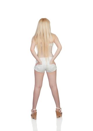 jeans apretados: Chica de espaldas con el pelo largo aislado en un fondo blanco