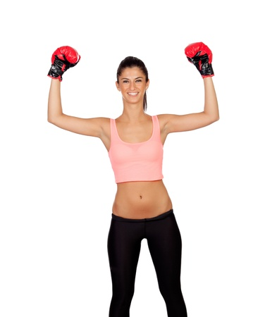 sportman: Attractive girl with boxing gloves isolated on a white background