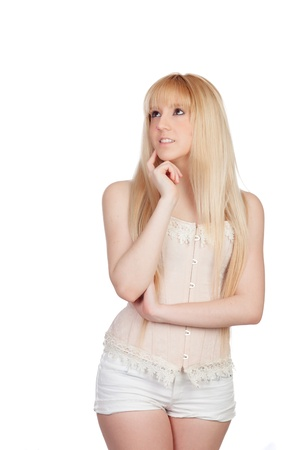 Pensive young girl with blond hair isolated on a over white background photo