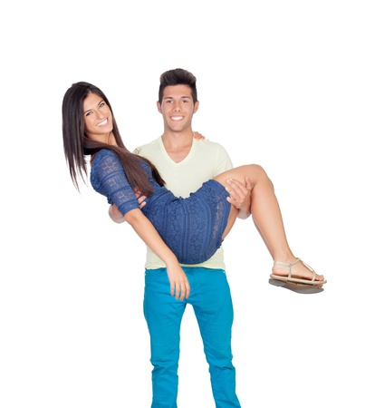 Young man carrying his girlfriend in his arms isolated on white background photo