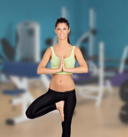 Beautiful woman doing yoga in the gym photo