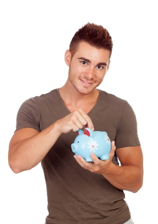 Young man with a money box isolated on a white background photo