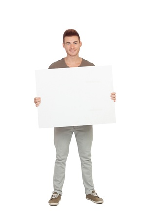 Attractive young man with a blank placard isolated on white background photo