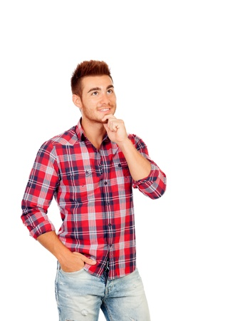 Pensive young man isolated on a white background photo