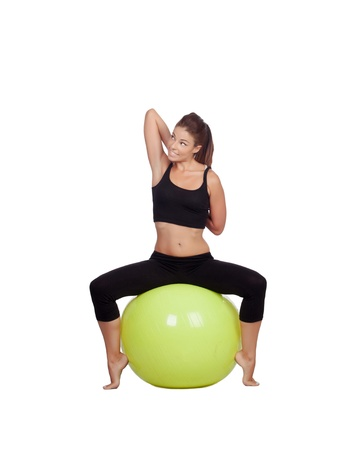 ball stretching: Young beautiful woman sitting on a gymnastic ball stretching arms on a white background