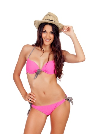 Attractive woman with pink swimwear and straw hat isolated on a white background