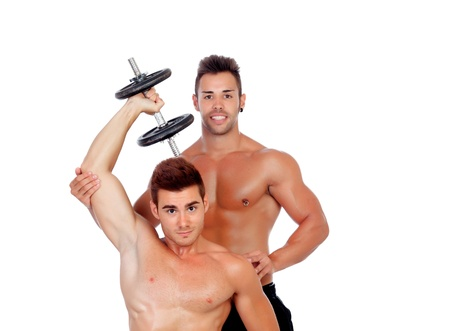 Couple of friends lifting weights isolated on a white background photo