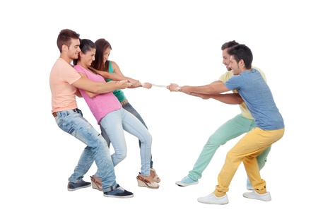 tug of war: Young people pulling a rope isolated on a white background