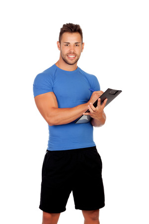 Handsome personal trainer with a clipboard isolated on a white background photo
