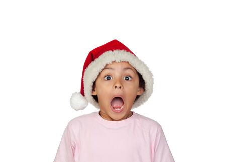 Shocked Girl Wearing Santa Hat Over White Background photo
