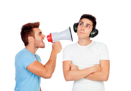 Young men screams to his friend through a megaphone isolated on a white background photo