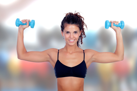 woman lifting weights: Beautiful woman do toning exercises with dumbbells