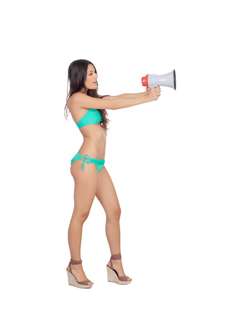 Beautiful woman in bikini with megaphone isolated on a white background photo
