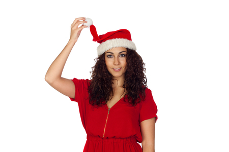 Attractive woman in red holding her Christmas hat isolated on white background photo