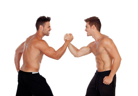 Couple of handsome muscled men competing isolated on a white background