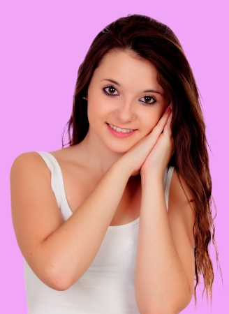 Beautiful girl with big eyes on a pink background photo