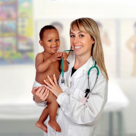 Adorable baby with his pediatrician isolated on a white background photo
