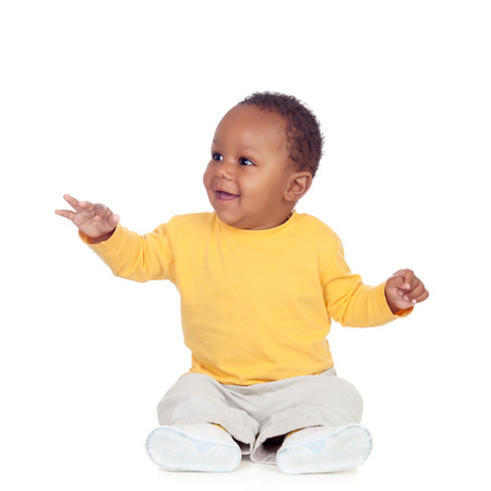 Adorable african baby sitting on the floor isolated on a white background Stockfoto