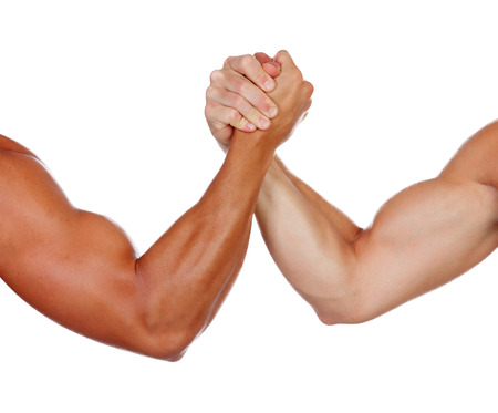 Two powerful men arm wrestling isolated on a white background Stock Photo