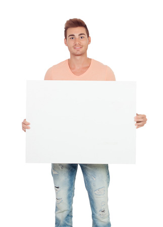 Attractive young man with a blank placard isolated on a white background photo