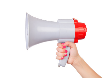 Female hand with pink nails holding a megaphone isolated on a white background Stockfoto