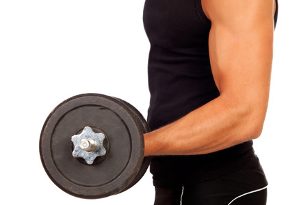 Handsome muscled with dumbbell isolated on a white background photo
