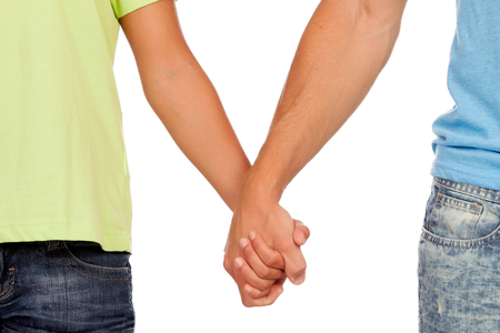 Hands clasped of two male lovers isolated on white background
