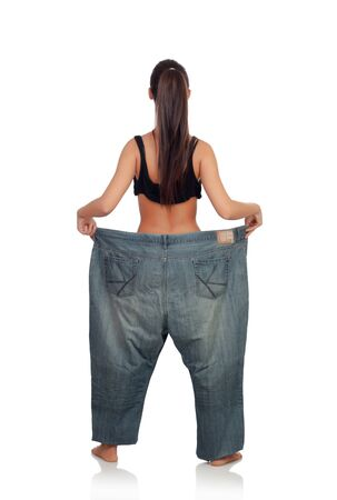 Slim woman back with huge pants isolated on a white background photo