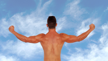 Handsome muscular man back with a blue sky  photo