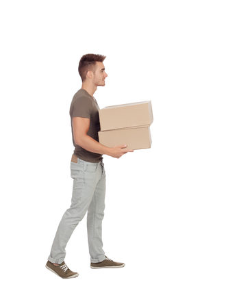 Casual young man carrying boxes isolated on a white background photo