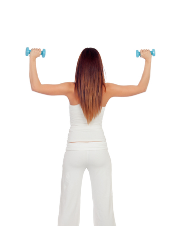 Attractive girl back in white toning her muscles isolated photo