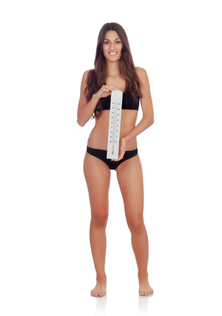 Girl in black underwear with a thermometer isolated on a white background photo