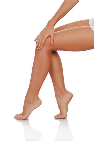 Beautiful female legs perfectly depilated isolated on white background photo