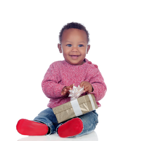 Adorable African American child playing with a gift box isolated on a white background photo