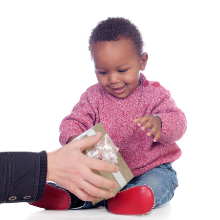 Adorable African American child playing with a gift box isolated on a white background Stock Photo - 23727926