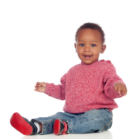 Adorable african baby sitting on the floor isolated on a white background Standard-Bild