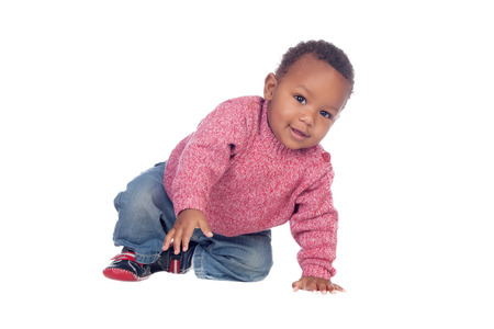 Beautiful African American baby crawling isolated on a white background Stockfoto
