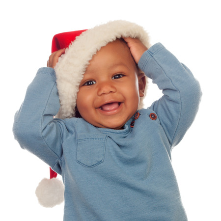 Adorable african baby with Christmas hat isolated on a white background