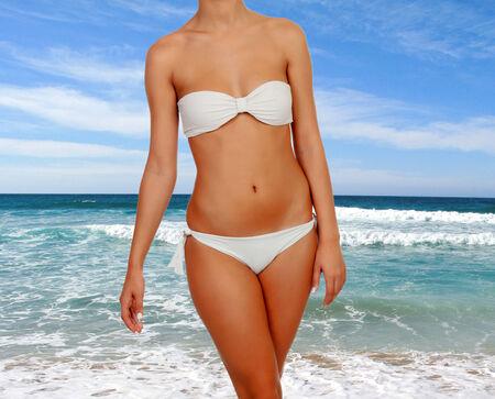sexy body: Beautiful female body with white bikini in the beach