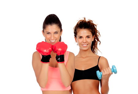 fitness couple: Couple of girls playing sports in gym isolated on white background Stock Photo