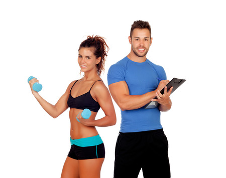 Handsome personal trainer with beautiful girl with dumbbells isolated on white Stock Photo
