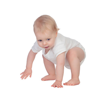 Adorable blonde baby in underwear crawling isolated on a white background photo