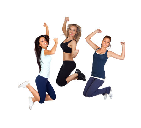 Three young girls jumping isolated on a white background photo