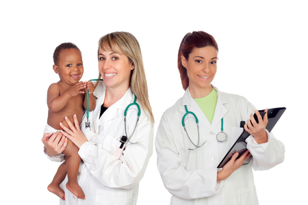 Pediatric medical team with one of his patients isolated on a white background photo