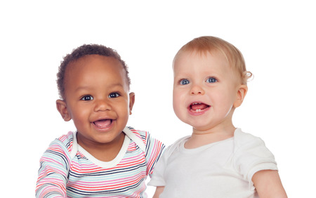 infants: Couple of Babies African and Caucasian laughing on white background