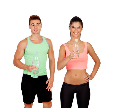 Young couple at the gym drinking water isolated on a white background photo