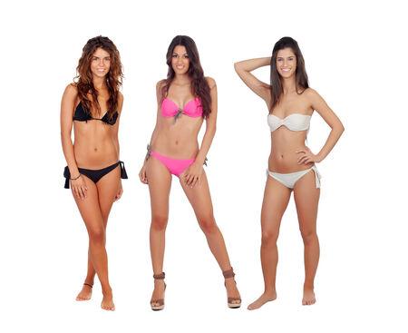 Three beautiful models in bikini isolated on white background photo